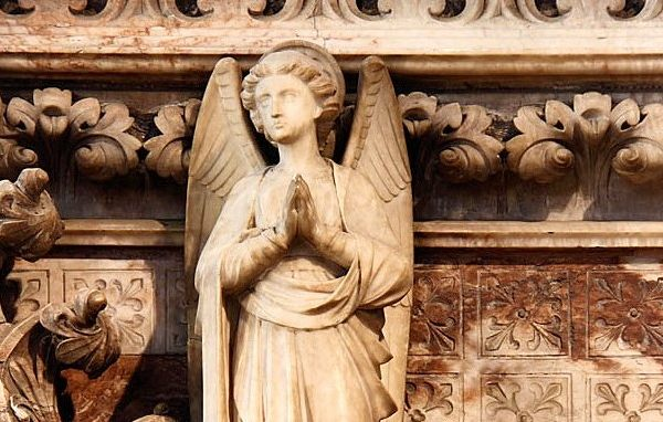 Angel carving praying